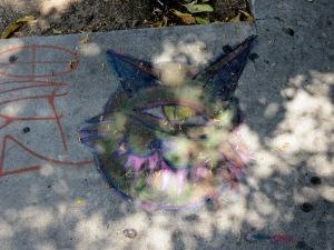 Creepy but cute chalk drawing.