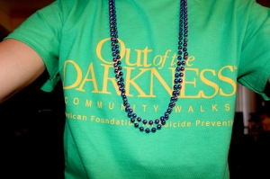 My shirt and beads. The purple one stands for someone who has committed suicide and the blue is if you support the cause.